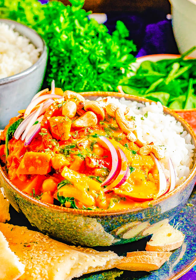 Thai Pumpkin Curry with Chickpeas — An EASY curry that's ready in 30 minutes! Tender fresh pumpkin, chickpeas, bell peppers, spinach, and more all bathed in the most aromatic Thai-inspired coconut milk broth! If you love Thai food, skip the restaurant and make this better-than-takeout curry at home!