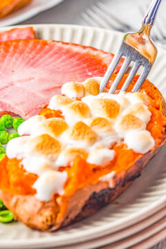 Twice Baked Marshmallow Sweet Potatoes - Sweet, creamy, decadent, and reminiscent of sweet potato casserole but individually portioned! FAST and EASY enough for family dinners or make them for more formal holiday celebrations! Either way, these are always the PERFECT comfort food side dish that everyone devours!